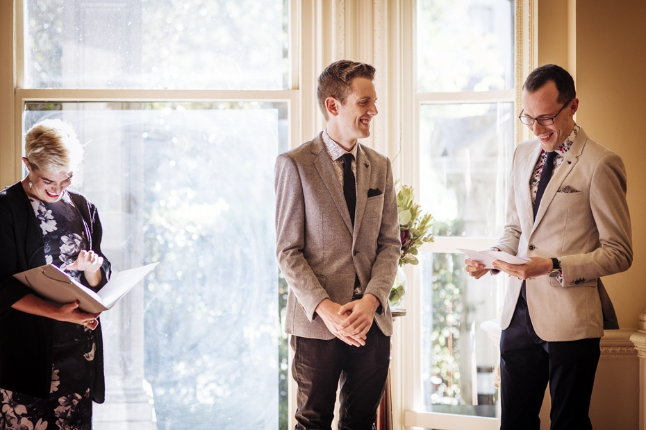 Celebrant and Grooms are all smiling at comment during one of the grooms vow's